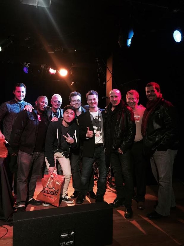 L to R:  Cole Carson (runner-up), Gorden Campbell (guest judge/panelist), Bob Terry (back, judge/panelist MI Faculty), Enrico Octaviano (front, winner), Donny Gruendler (judge/panelist), Stewart Jean (host), Kenny Aronoff (guest judge/panelist), Bruce Jacoby (Remo), Russ Miller (guest judge/panelist).