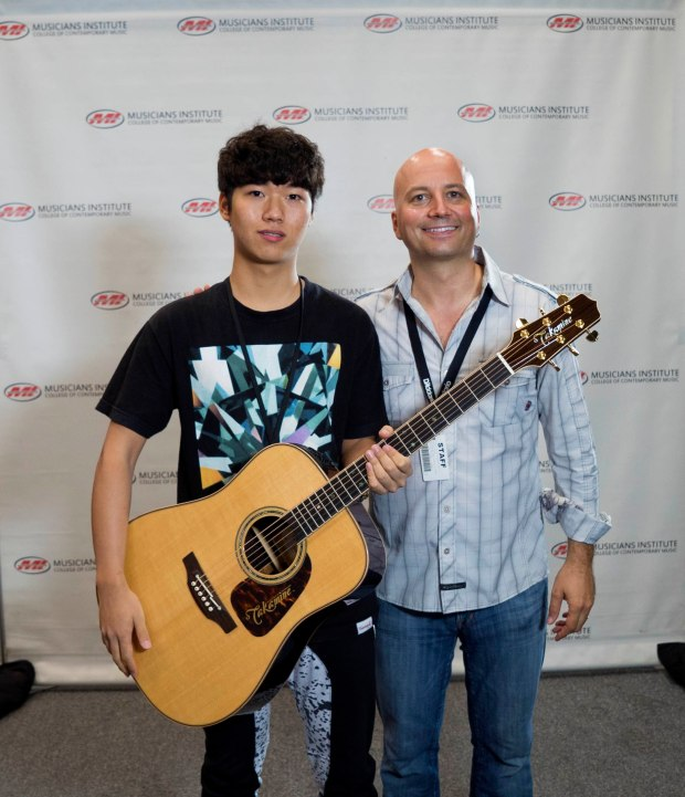 Jintao Yao (l.) with Guitar Program Chair Stig Mathisen (rt.)