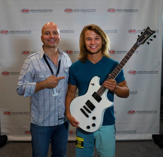 Logan McGarry (holding guitar) with Guitar Program Chair Stig Mathisen