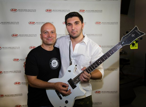 (l.) Guitar Program Chair Stig Mathisen with Sinan Yildiz (rt.)